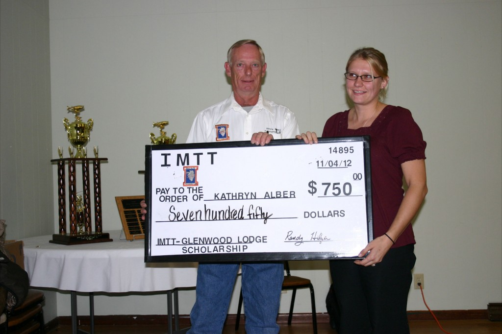 IMTT President Howard Chambliss presents the 2012 IMTT - Glenwood Lodge Scholarship to winner Kathryn Albers. November, 2012.